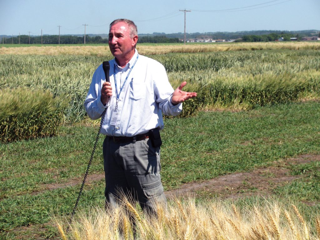 Lacombe-Field-day-2014-Mazen-Aljarrah-speaks-to-local-growers